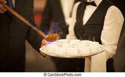 Queimada burning hot alcohol drink waiter in wedding -...