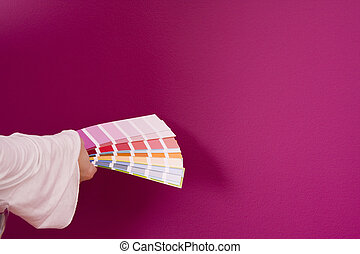 select a color - woman select a color to paint her wall