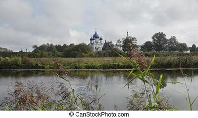Beautiful view through the river of Cathedral of the Nativity of the Virgin (XIII-XIX.) in Suzdal, Russia
