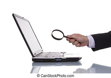 Finding information - businessman finding data in a laptop