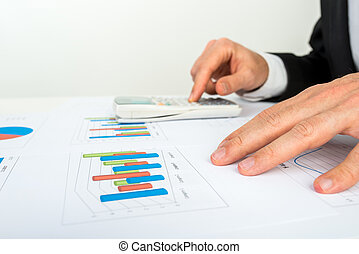 Businessman analysing a bar graph - Close up view of the...