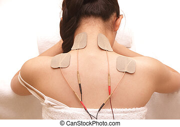 Asian woman is doing massage of electrical -stimulation TENs...