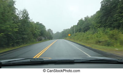 Driving POV in Muskoka. - Driving on a misty morning. Corner...