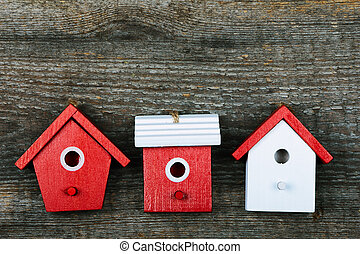 Birdhouses - Three birdhouses painted with red and white...