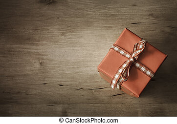 Overhead Gift Box on Wood - Angled - A square gift box, set...