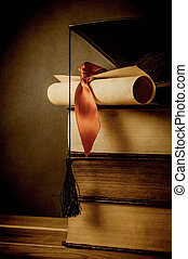Education and Graduation Concept - Vintage - A stack of old...
