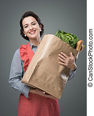 Vintage woman with grocery bag - Smiling vintage woman in...
