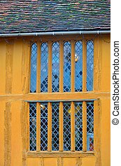 yellow timbered house with window - Yellow timbered house