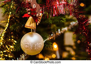 White Christmas Baube - A small ornamen hanging in the...