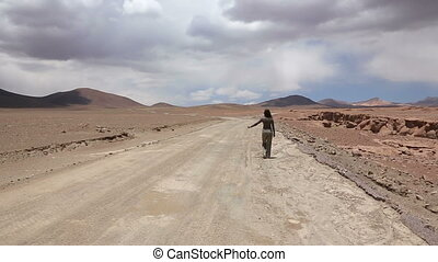 Woman on the road - Woman hitchhiker at at deserted road,...