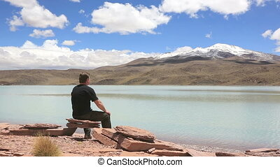 Man talking on the phone - Man sitting on the shore of...
