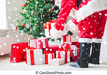 close up of santa claus with presents - holidays,...