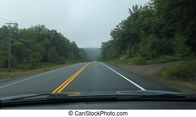 Driving POV in Muskoka. - Driving on a misty morning. Dark,...