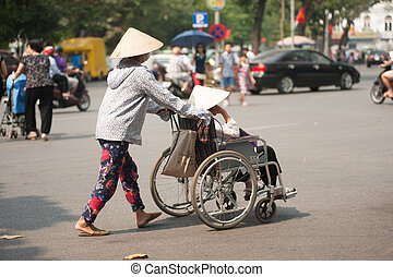 Wheelchair on street in Hanoi,Vietnam