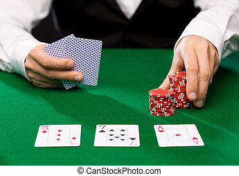 holdem dealer with playing cards and casino chips - casino,...