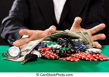 poker player with chips and money at casino table - casino,...