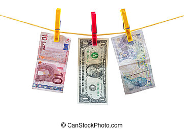 Different currency banknotes hanging on clothesline isolated...