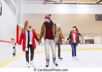 happy friends on skating rink - people, friendship, sport...