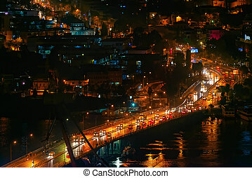 Traffic over bridge during night time - Traffic over the...