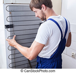Handyman and fridge repair - A handiman in work clothing...