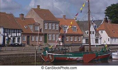 RIBE, DENMARK - boat moored at quay in Ribe harbor - RIBE,...