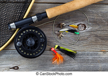 Fishing Fly reel with accessories on wood - Close up top...