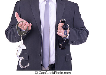 Businessman holding handcuffs and ball gag. Isolated on...
