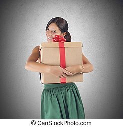 Big present - Happy girl receives and embraces a great gift