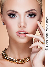 Jewelry - Young lady with luxury accessories on beige...