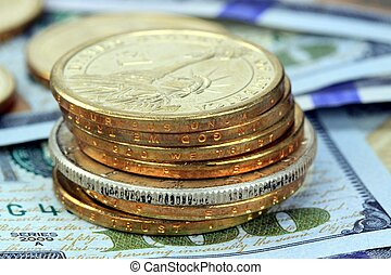 Gold and Silver Coins with US Currency