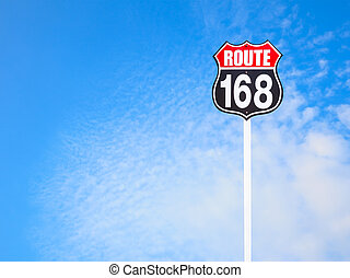 vintage route 168 road sign and blue sky