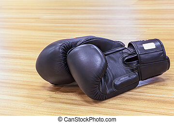 Boxing gloves black color on wooden floor