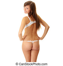 Young woman in underwear, is isolated on white background