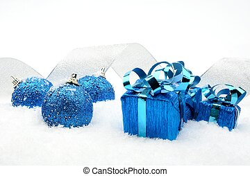 Blue christmas gifts,baubles silver ribbon on snow -...
