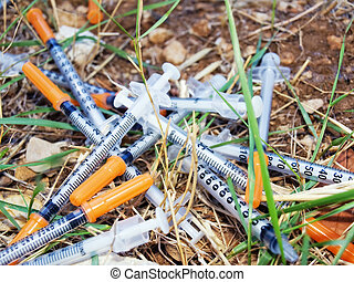 Consumed doses - Used syringes discarded somewhere in nature...
