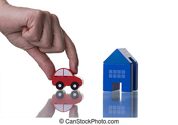 The life investment - a hand showing a house and a car...
