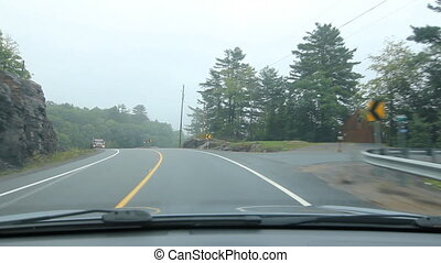 Curvy road. Approaching dump truck. - Driving on a misty...