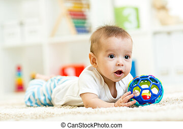 baby boy playing with toy indoor - baby boy playing with toy...