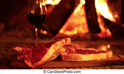 Raw Beef Steaks And Fireplace