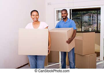 african american couple moving