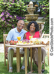 Senior African American Couple Healthy Eating Outside - A...