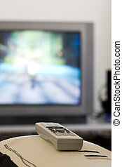 TV remote control - a remote control pointing to a TV...