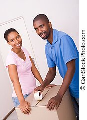 african moving couple - an african couple moving home...