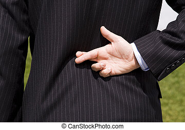 Businessman lie - a businessman telling a lie with the...