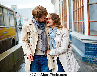 Affection - Young couple taking walk in urban environment
