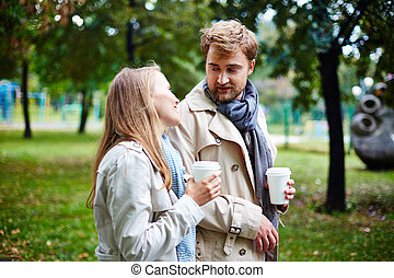 Walk in park - Affectionate dates with drinks taking walk in...