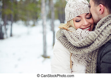 Happy girl - Young female in winterwear with her boyfriend...