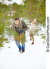 Snowball play - Young guy running from his girlfriend...