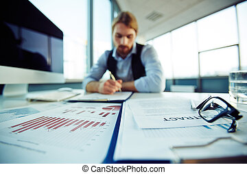 Office environment - Business objects on background of...