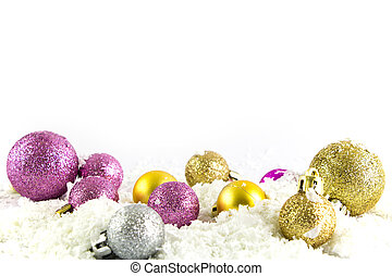 Various sized and colored Christmas balls with snow isolated on white